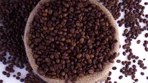 Dark Coffee Grains. Rotating and falling. Coffee beans. Close up of seeds of coffee. Beautiful seeds of coffee.
