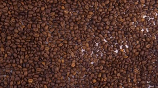 Brown coffee beans, of coffee beans for background and texture. Beans of roasted black coffee.