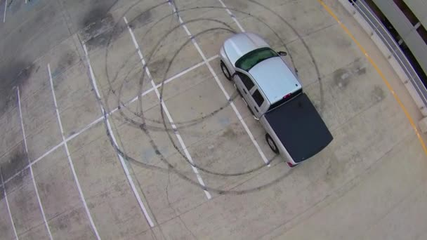 circling over car in parking lot