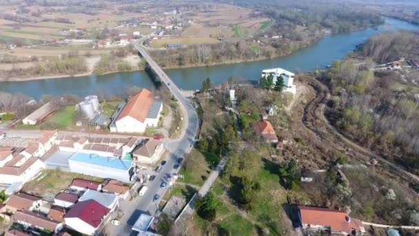 Small modern agricultural Serbian village Varvarin in central Serbia aerial view with houses fields and west Morava river