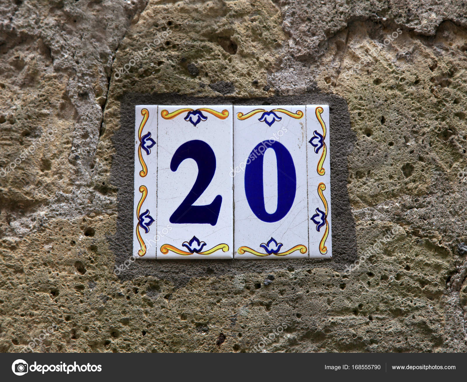 House number twenty 20 ceramic tiles with blue figures on old