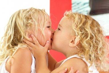 Little girls kissing each other