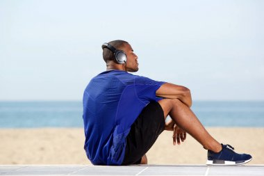 African man listening to music