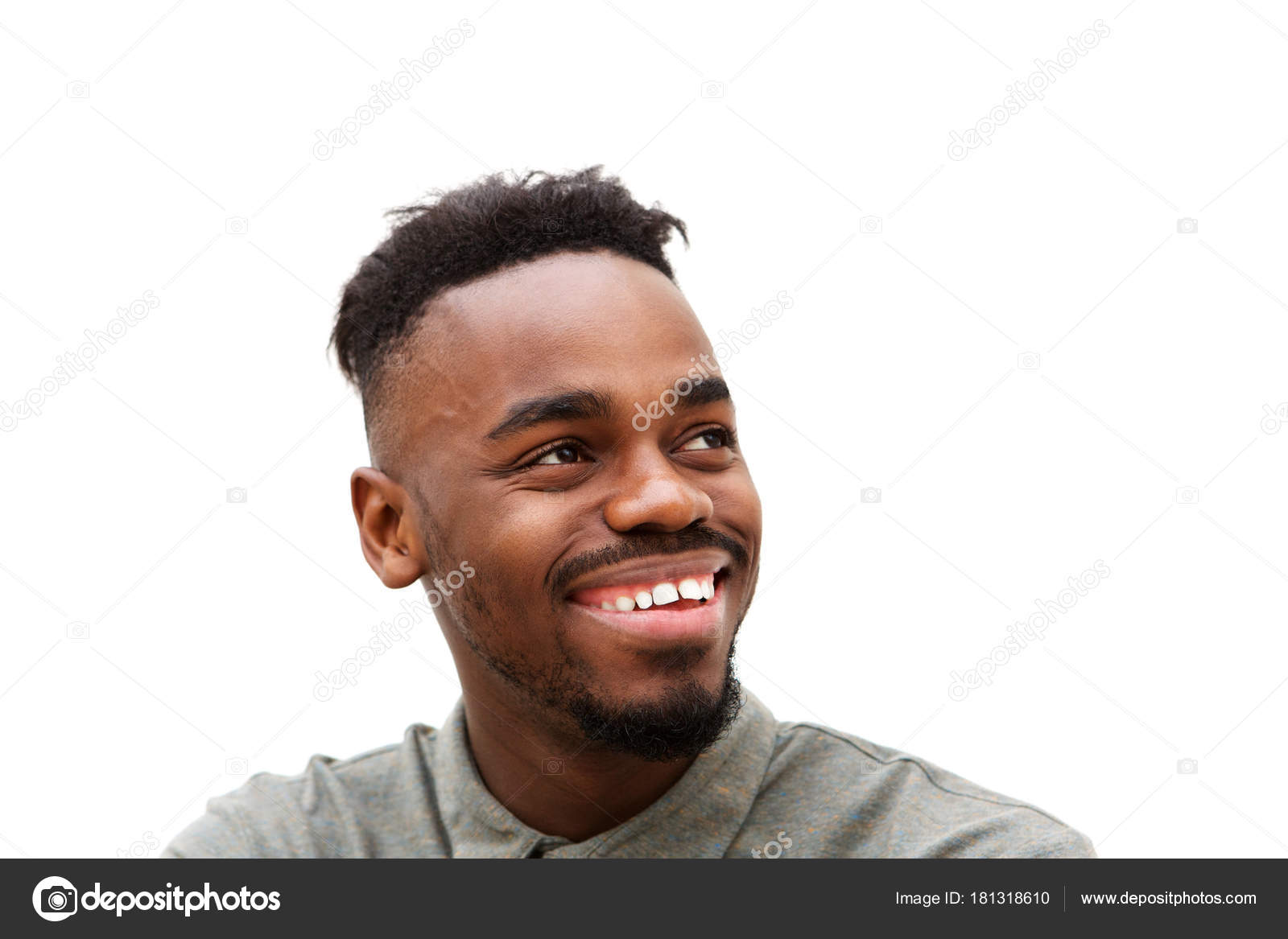 da8e22db81a Close up portrait of young black man smiling and looking away against white  background — Photo by mimagephotos