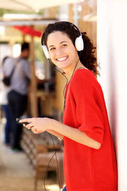 Portrait of young woman with smartphone and headphones