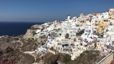 4k video. amazing romantic white houses in Oia, Santorini island, Greece. with a panoramic view of the whole cliff