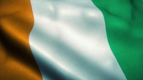 Ivory Coast flag waving in the wind. National flag of Ivory Coast. Sign of Ivory Coast seamless loop animation. 4K