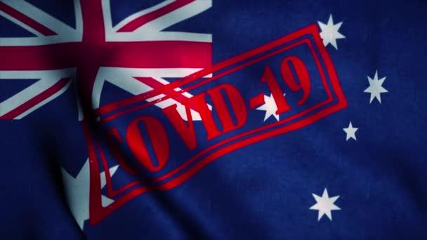 Covid-19 stamp on the national flag of Australia. Coronavirus concept