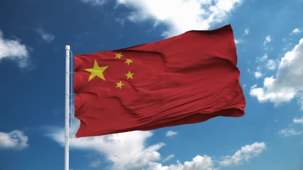 Realistic flag of China waving in the wind against deep blue sky.