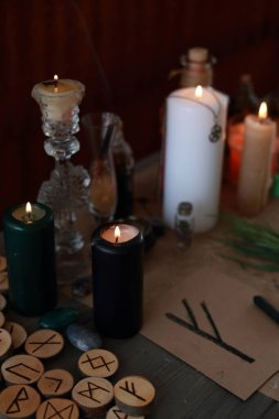 magic ritual with runes and pentagram and magical attributes