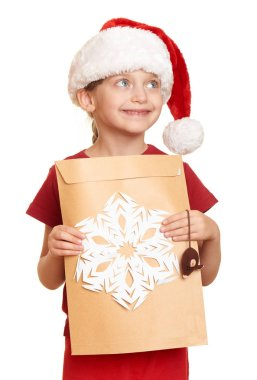 girl in red hat with letter to santa - winter holiday christmas concept