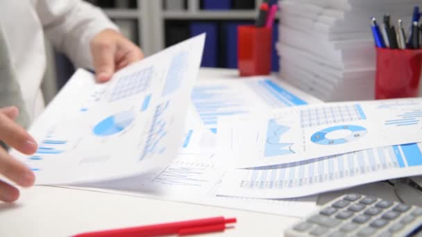 Businessman working and calculating, reads and writes reports. Office employee, table closeup. Business financial accounting concept.