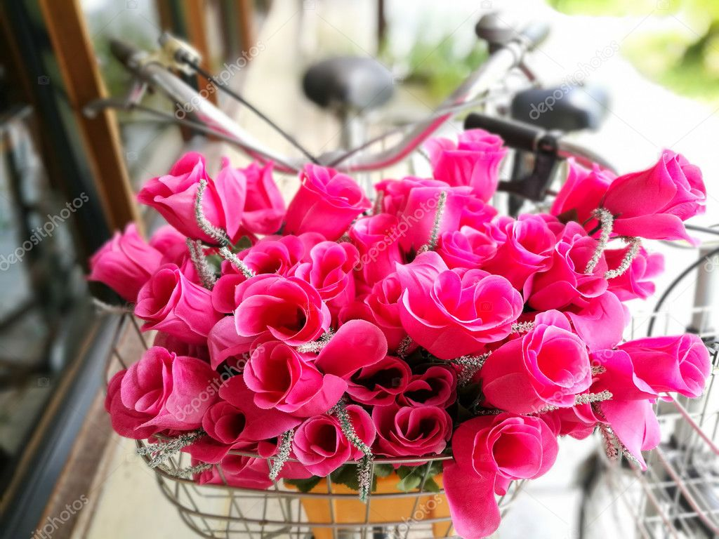 Fake pink flowers in bike basket stock photo blanscape 126386132 fake pink flowers in bike basket stock photo mightylinksfo