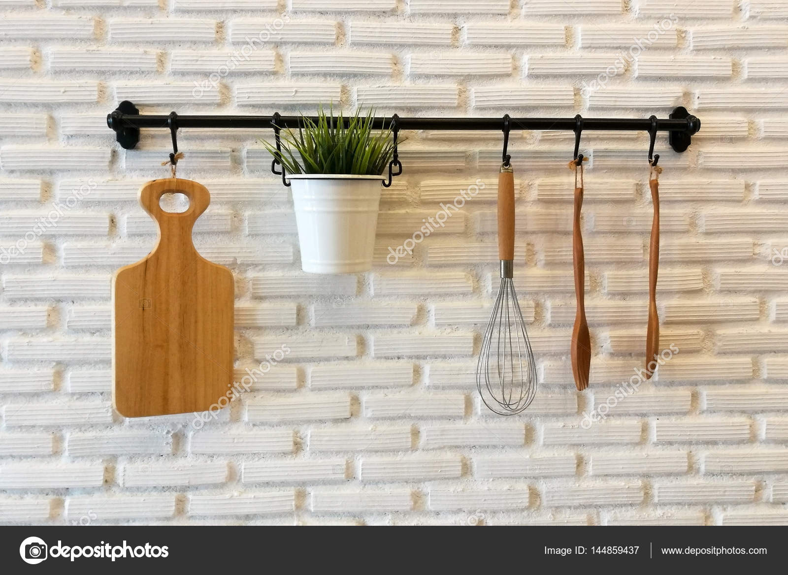 Wooden cookware on kitchen brick wall — Stock Photo © blanscape ...
