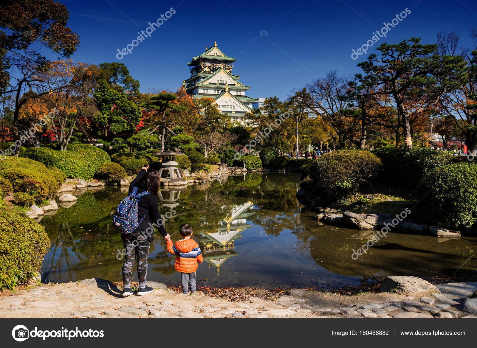 Family visit Osaka castle at fall, Japan – Stock Editorial Photo ...