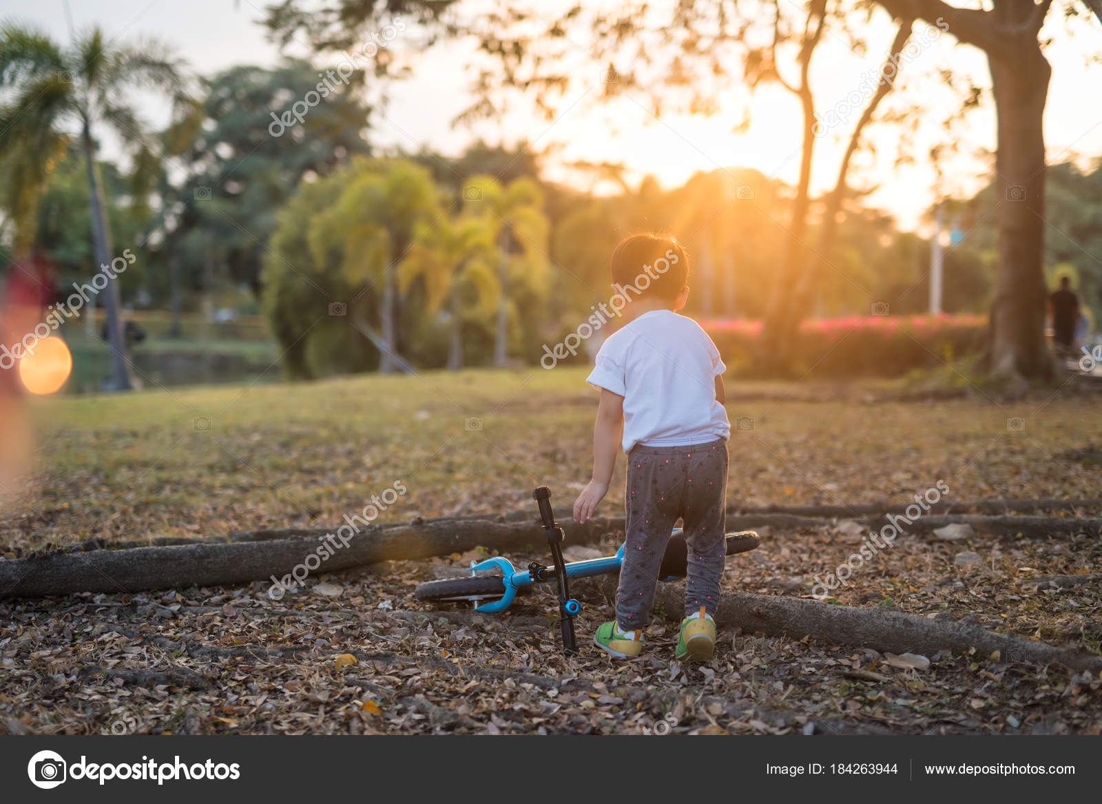 Asian boy get and ride bicyc;e — Stock Photo © blanscape #184263944