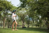 Asian girl play smartphone in park