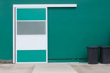 Sliding door against green wall