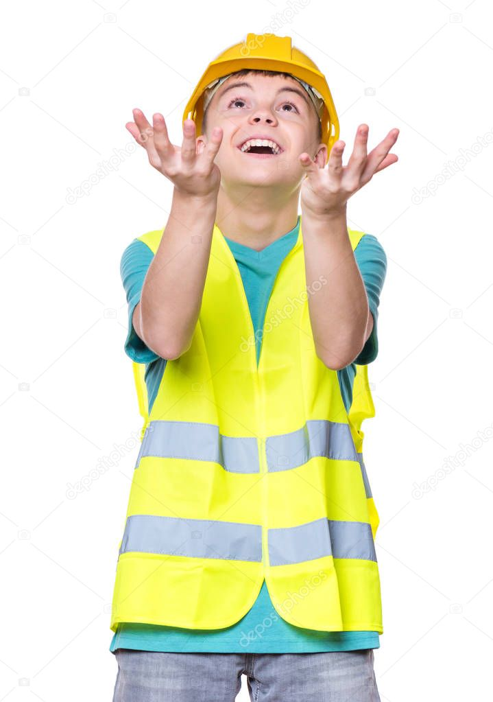 Boy wearing yellow hard hat