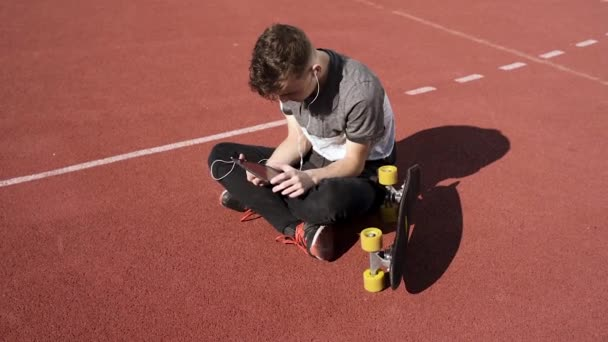 Teen boy with headphones and tablet