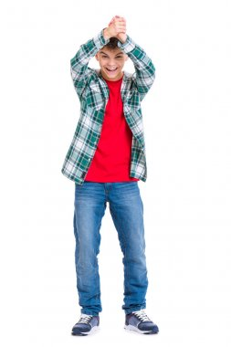 Full length portrait of young caucasian teen boy isolated on white background. Victory screaming funny teenager. Handsome winner child with his hands up looking at camera.