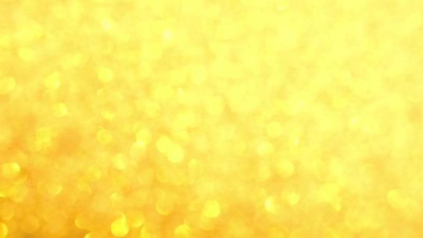 Dekoratív disszidált absztrakt arany háttér csillogó csillogás. Ünnepi és ünnepi háttér szöveg. 4k felvétel
