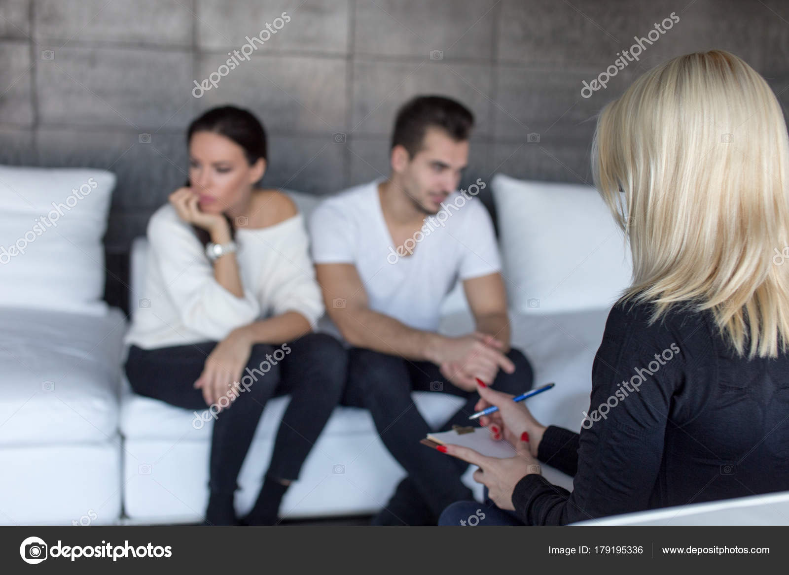 Couple Therapist Writing Down Situation On Therapy Stock Photo
