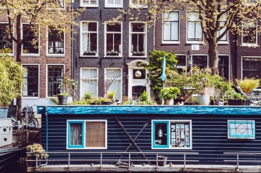 Amsterdam typical dutch houses and houseboat, Holland, Netherlands