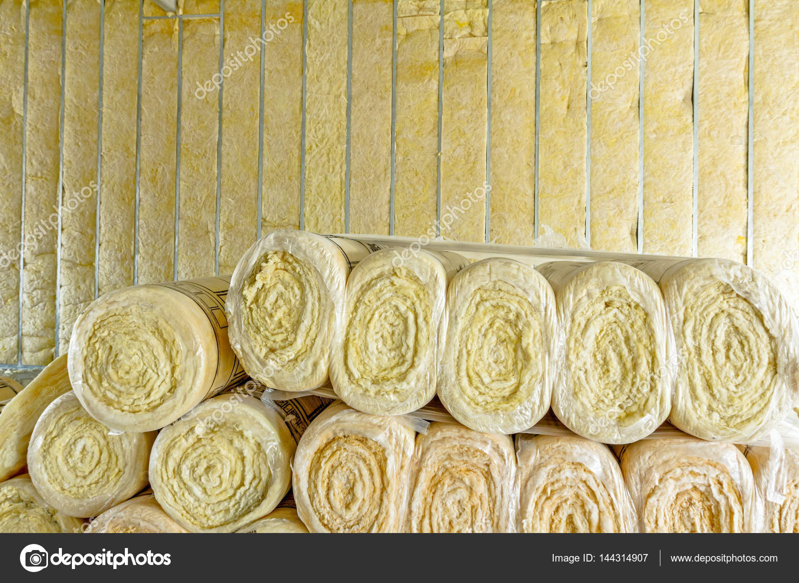 Stack of thermal insulation material in roll is wrapped with