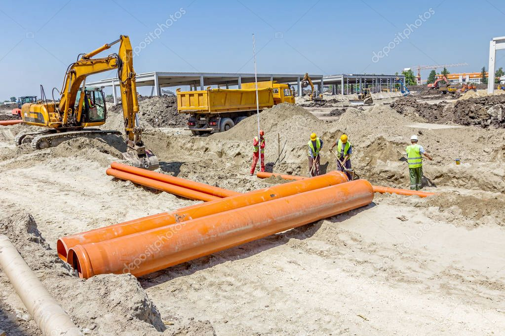 Placing new plastic pipes into the ground