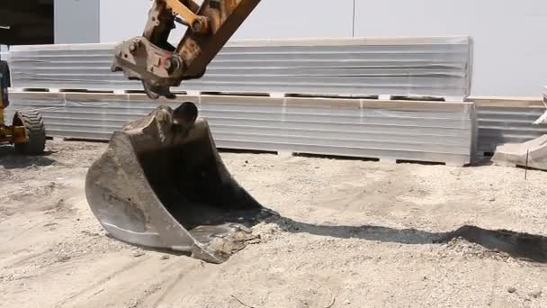 Excavator changes his bucket.Excavator is replacing tool, bucket at construction site.