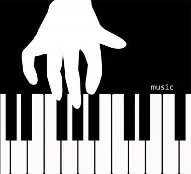 Hand touching the piano