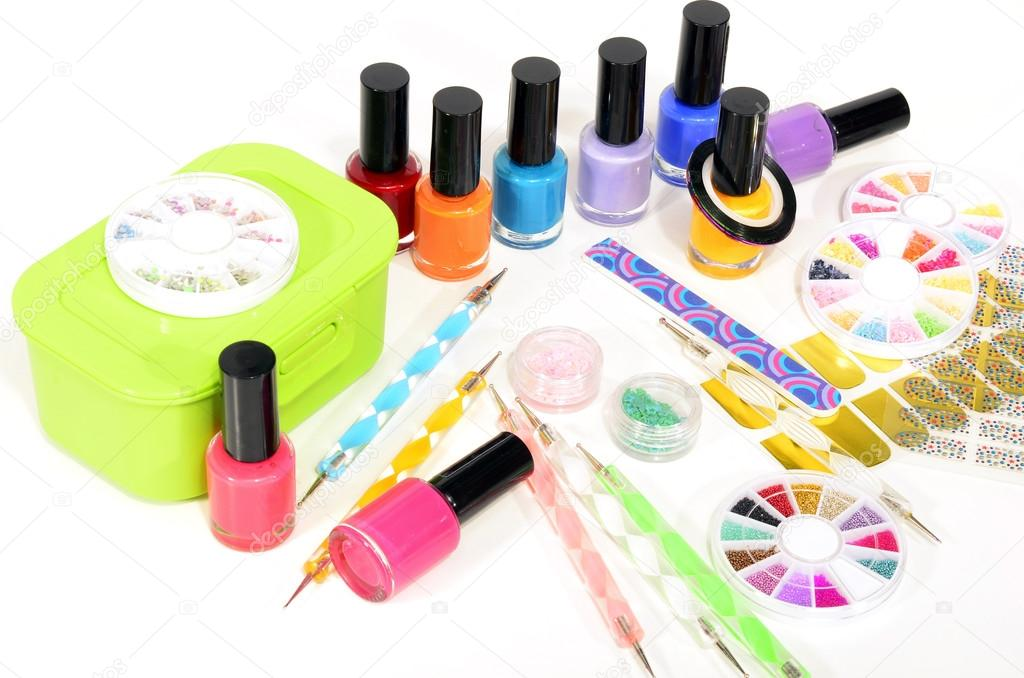 Table full of manicure ustensils, coloured nail polish,nail decals ...