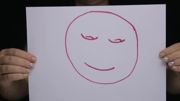 A woman at a psychologists consultation shows her mood with a colored emoticon