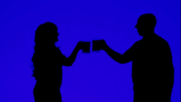 Silhouette of a woman and a man drinking beer from mugs on a blue background
