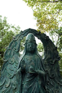 A statue of syncretism (?). It looks like Guanyin (or Kanon in J