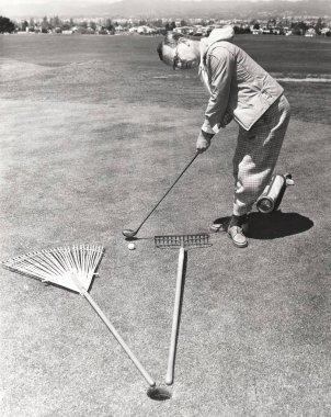 man hitting ball