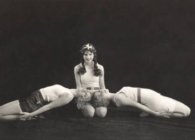 women performing dance on stage