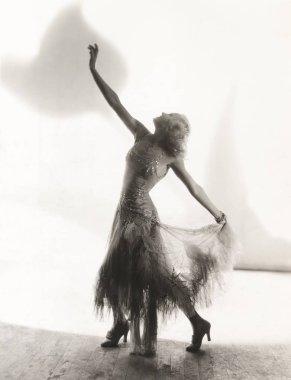 woman dancing against wall