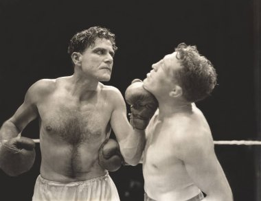 Angry boxer punching competitor