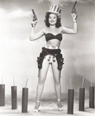 woman in bikini holding guns