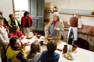 LONDON - CIRCA 2014: Chefs in traditional dress demonstrate cookery at the Royal Kitchens, Kew Gardens, London, UK