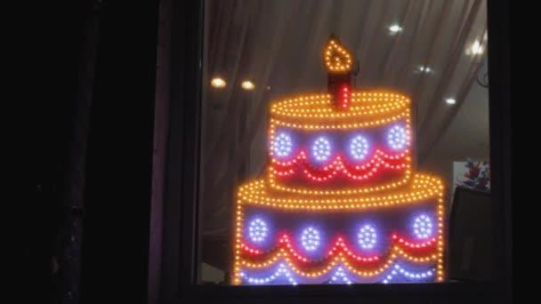 decoration led illumination celebratory cake at the window. electric billboard