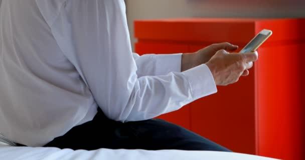 Mature businessman using laptop in hotel room 4k
