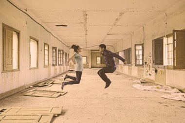 Couple jumping interior