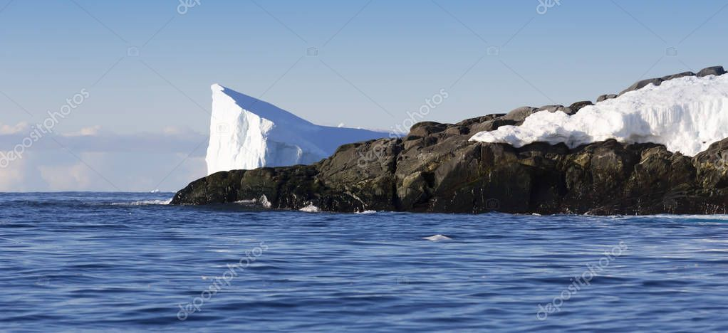 Icebergs of various forms and sizes.