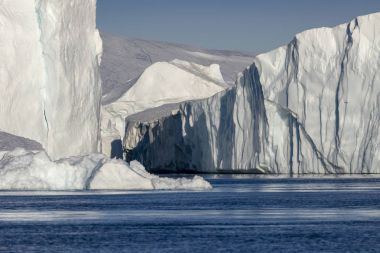 Nature and landscapes of polar zones of our planet.Travel on the scientific vessel among ices. Studying of a phenomenon of global warming. Ices and icebergs of unusual forms and colors..