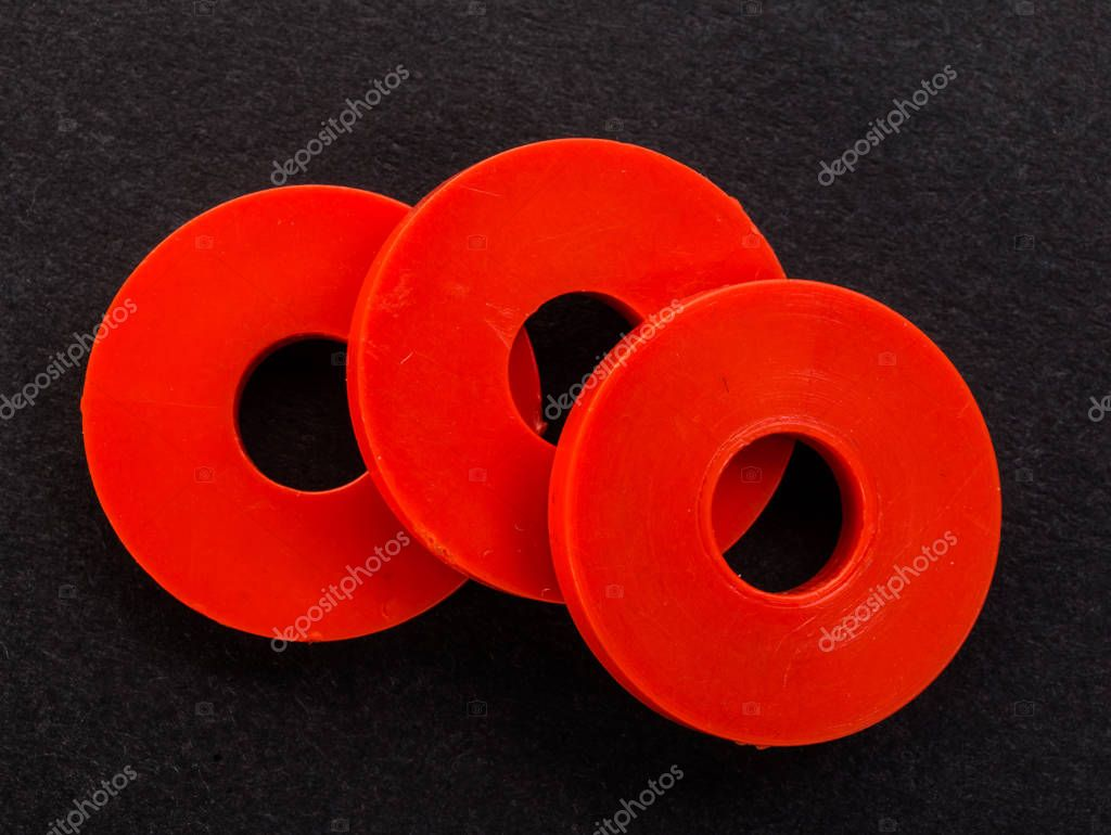 red plastic gaskets on a black background — Stock Photo © leitmotif ...