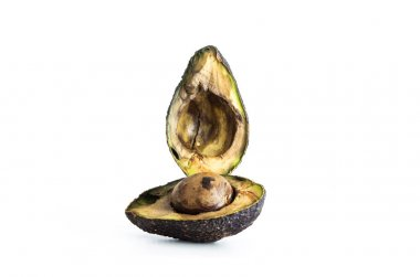 Halved rotten spoiled avocado fruit and seed macro close up shot isolated on pure white 2020