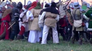 Reconstruction of the medieval armor fight with hand weapons